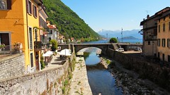 River Course to Lake Como - Argegno Italy (Gilli8888) Tags: bridge windows italy lake mountains alps water buildings river rocks riverbed lakecomo lombardia lombardy archbridge argegno