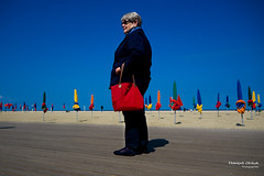 Street - To be a beach umbrella in Deauville (Franois Escriva) Tags: street blue light red sea sky people orange woman sun france green beach yellow bag photo sand holidays candid streetphotography olympus normandie umbrellas rue omd deauville