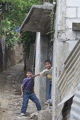 """Get a grip little brother."" (Pejasar) Tags: street home boys tin brothers guatemala hill stlouis cobblestones grip"