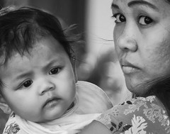 Mother and Daughter (FotoGrazio) Tags: street family portrait people blackandwhite woman baby art face kids composition contrast children asian photography kid eyes infant child photoshoot faces philippines expressions streetphotography streetportrait streetscene portraiture filipino filipina moment photographicart capture emotions motherandchild socialdocumentary motheranddaughter digitalphotography informalportrait pacificislanders dualportrait documentaryphotography sandiegophotographer informalportraiture artofphotography flickrelite californiaphotographer internationalphotographers worldphotographer photographersinsandiego fotograzio photographersincalifornia waynegrazio waynesgrazio