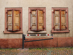 Three Windows (Batikart) Tags: city travel autumn windows red vacation urban brown house black building rot fall wall architecture canon germany geotagged outdoors deutschland three wooden october gate holidays europa europe closed stripes fenster patterns wand details urlaub herbst rustic citylife symmetry cobblestone textures stadt shutters architektur bouldering barrier braun cobbles ursula picturesque holz gebude schwarz mauer drei streifen rheinlandpfalz sander g11 2014 schranke symmetrie kopfsteinpflaster geschlossen rhinelandpalatinate rustikal 100faves schlagbaum 200faves 300faves 400faves batikart neustadtanderweinstrasse canonpowershotg11 exteriorwallofahouse
