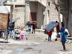 Carrying mattresses home in Aleppo (Ummah Welfare Trust) Tags: poverty winter children war refugee islam arabic east relief hunger arab middle shaam humanitarian aleppo displaced humanitarianism ummah idlib