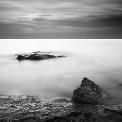 From an Ephemeral Sunrise (DavidFrutos) Tags: longexposure sea bw costa naturaleza seascape beach nature water monochrome rock clouds sunrise landscape coast pier mar agua rocks waves fineart wave playa paisaje bn alicante amanecer filter le lee nubes nd canondslr olas roca rocas ola 1x1 waterscape filtro largaexposición filtros espigón gnd neutraldensity canon1740mm gnd4 graduatedneutraldensity densidadneutra davidfrutos 5dmarkii niksilverefexpro bwnd8 hitechreversegnd06