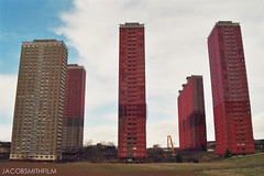 Red Road Flats (JacobSmithFilm) Tags: poverty road uk blue red sky people colour building tower 1969 film grass weather architecture clouds 35mm buildings landscape concrete gold scotland high nikon kodak decay glasgow jacob poor vivid social smith gritty demolition flats 200 saturation highrise housing blocks 1960s rise britian brutalist f401 jacobsmithfilm