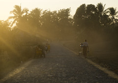 Dusty Road In The Sunset, Mrauk U, Myanmar (Eric Lafforgue) Tags: road travel sunset sunlight horizontal photography asia day ray traffic adult burma myanmar dust groupofpeople birmanie rakhine mrauku arakan traveldestinations  birmania mianmar   mrohaung rakhinestate   barma  mianm      birmanya    mjanmar mjanmarsko pa burma0466 sittwedistrict