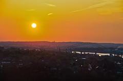 Runcorn sunset (stumpyheaton) Tags: uk bridge sunset red england sky sun castle yellow night river outside golden nikon village cheshire cathedral hill rays nikkor 18200 mersey runcorn merseyside widnes halton d5100