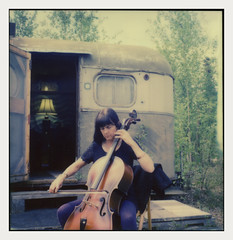 Laura (R. Drozda) Tags: music laura alaska polaroid sx70 nemo cello fairbanks beingthere northpole drozda ravenveterinaryclinic msystemtrailer impossiblecolorsx70film goodbyesalty