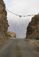 Road through Rocks (Shakti Priyan Nair) Tags: road trip mountain snow mountains landscape cloudy outdoor pass snowcapped roads leh ladakh khardungla enroute highest clouded motorable