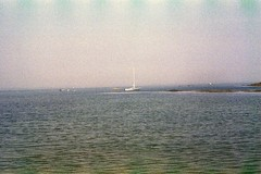 (taylor anne medwid) Tags: ocean lake film beach nature water sailboat 35mm canon landscape boats outside outdoors boat massachusetts grain 35mmfilm cape grainy canonae1 naturephotography filmphotography