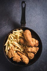 Chicken time (Uros Zunic (Belgrade photography guid, contact me)) Tags: from old food black hot chicken dinner ads menu studio table lunch cuisine restaurant golden wooden tv wings junk shoot shot drink sauce cut space empty fat leg deep tasty nobody bbq frenchfries meat roast grill delicious indoors eat potato fries american charcoal barbecue blank poultry meal drumstick junkfood pan snacks diet grilled fried unhealthy appetizing
