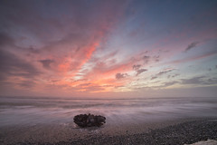 Greymouth Sunset (Nicks.Place) Tags: longexposure sunset sea cloud seascape beach water weather rock canon landscape outdoors photography eos photo colours stones wave driftwood westcoast cloudscape greymouth movingwater westcoastnz nicksplace 5dmarklll