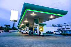 Gas station at night (otoxunghe) Tags: china station sign price night energy asia tank diesel empty cost gas number pump malaysia oil kualalumpur petrol gasoline rise expensive cheap refinery premium fuel liter fill unleaded petroleum gallon expense costing