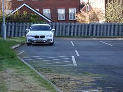 Protectionist Parking (stevenbrandist) Tags: white lines car damage bmw carpark loughborough loughboroughcollege bc15uev