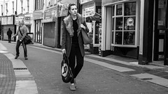 Fashionable (Howie Mudge LRPS) Tags: road street uk travel windows portrait urban blackandwhite bw woman man male travelling monochrome fashion wales architecture female buildings walking outside outdoors mono blackwhite pretty doors pavement walk candid cymru bangor streetphotography streetlife monochromatic panasonic attractive shops casual walls gwynedd urbanphotography m43 mft micro43 microfourthirds mirrorlesscamera compactsystemcamera lumixgvario1442f3556ii micro43mountlenses panasonicdmcgx8 169perspective