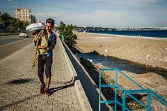 Travelling salesman (Melissa Maples) Tags: road street sea man beach water skyline turkey nikon asia mediterranean trkiye antalya prom walkway vendor nikkor vr turk afs  18200mm  f3556g midye  18200mmf3556g d5100 konyaaltbeach