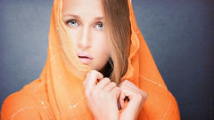 Orange state of mind (Tommy Hyland) Tags: blue portrait orange woman eye beautiful beauty face female person one model eyes holding eyecontact veil expression feminine indoor lips human contact colourful