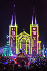 Santa Claus is Comming. (baddoguy) Tags: christmas people church vertical architecture night thailand photography cathedral audience symbol religion praying happiness parade celebration event midnight santaclaus thaiculture gothicstyle colorimage traditionalfestival locallandmark largegroupofpeople templebuilding holidayevent