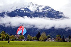 ONE WITH NATURE (shreyak25) Tags: light vacation sun nature clouds landscape switzerland bright paragliding geographic