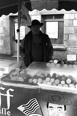 """Merci.... Heu... De rien ..."" - Plestin-Lès-Grèves, Bretagne - France- Fe. 2015 (The Blue Water Lily's Company) Tags: street portrait blackandwhite bw france blancoynegro film monochrome analog rural work 35mm reflex nikon brittany noiretblanc grain bretagne nb scan breizh mercado travail epson hp5 monochrom nikkor rue mercato ilford biancoenero breton f801s afd cotesdarmor lc29 24x36 schwartzweiss schwatzweiss tripier v370 fdrouet"