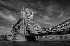 Tower Bridge (James Waghorn) Tags: city bridge england urban blackandwhite london tourism water thames clouds towerbridge spring nikon flag famous landmark contrails vignette d7100 topazclarity silverefexpro2 sigma1750f28exdcoshsm