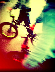 BMX Riders - London Street Photography (Nicholas Goodden) Tags: city people urban london bike bicycle photography bmx candid citylife streetphotography olympus minimal motionblur saturation londres faceless streetphoto unposed anonymous londra riders urbanlife urbanphotography anonymity londoners streetphotographer photoderue notposed streetsoflondon urbanphotographer mirrorless unrecognisable microfourthirds