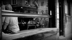 2005. Where you meet the locals. (jaap spiering   photographer) Tags: 2005 people blackandwhite bw food coffee monochrome bar restaurant locals zwartwit streetphotography coffeeshop denhaag mens thehague lunchroom lekker eten brasserie coffeebar mensen koffie 070 denneweg jaapspiering jaapspieringphotographer jaapspieringfotografie