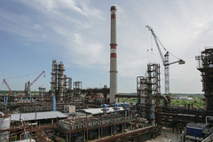 Between the two cranes (algimantas_tirlikas) Tags: chimney building work outdoor pipeline rafinery