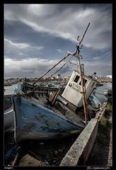 En reparacin (meggiecaminos) Tags: blue sky azul clouds barca nuvole barco ship workinprogress morocco cielo nubes marocco fishingboat marruecos azzurro asilah enreparacin