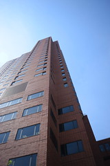 Baltimore Building (Sam DeGenova) Tags: baltimore buildings city cars sun shine reflections people street america