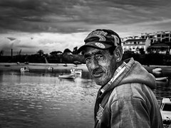 Fisherman (Vitor Pina) Tags: street portrait people urban blackandwhite man streets men monochrome contrast portraits photography pessoas moments faces candid portait streetphotography m urbano fotografia scenes pretoebranco pina momentos