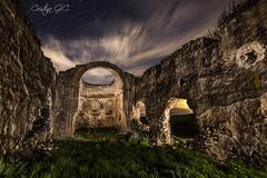 ENTREMUROS. (Cristina G.C.) Tags: ermita nocturna ruina linterna night cielo estrellas nubes segovia