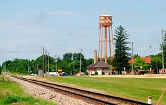 Canadian National Railroad going through Warren, Illinois (Cragin Spring) Tags: watertower midwest il illinois railroadtracks railroad rail warren warrenil warrenillinois usa
