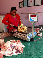 Local butcher (whitworth images) Tags: nepal red woman scale bench person asia raw counter head knife goat fresh meat butcher cutting marble pokhara kaski indiansubcontinent