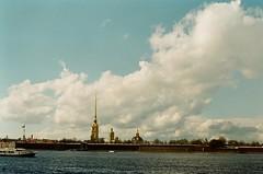 April in Saint Petersburg. Peter and Paul Fortress (OlmecaG) Tags: city bridge sky film architecture clouds 35mm cityscape russia saintpetersburg saintp