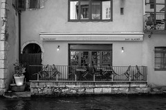R. (mrsrosebud) Tags: blackandwhite white black alps annecy water caf monochrome bar alpes river lago monocromo agua eau lac cafeteria greyscale frenchalps rhonealpes alpesfranceses