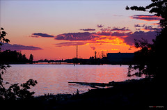 The Sun Sets Down The River (Clayton Perry Photoworks) Tags: sunset canada vancouver clouds spring bc silhouettes steveston explorebc explorecanada