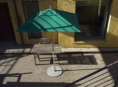 Green Sunshade (geowelch) Tags: patio urbanfragments dundasstwest olympus17mmf28 olympusepl5
