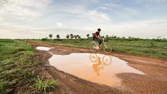Homeward bound. Dirt road between Phsar Krom and Kampong Ous. (freebird) Tags: reflection bicycle rural countryside cambodia khmer village farm wideangle farmland dirtroad kampuchea kampongchhnang
