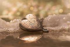 Take my Heart (charhedman - away on vacation) Tags: anniversary silverlocket vintage mother heart reflections macro bokeh lace