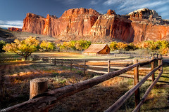 Gilford Farm Barn in Fall (winka_photography) Tags: ranch trees red wild usa mountains west fall apple barn america fence utah nationalpark cowboy rocks farm laub herbst foliage route capitol 12 reef canyons bauernhof frontier fruita scheune obstbume apfelbume