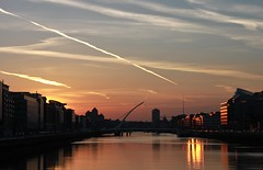 Silk and gold (aoiharu) Tags: ireland sunset sky dublin sun reflection backlight clouds river golden dusk silhouettes liffey contrejour goldenhour