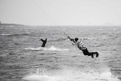I`m Flyyiiiing!!! (Samuli Koukku) Tags: sea bw sport finland fly blackwhite helsinki wind outdoor balticsea kiteboarding kitesurfing lauttasaari watersport