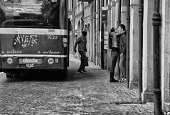 bus stop (Maurizio Targhetta) Tags: city people love kiss cityscape citylife streetphotography busstop bologna fujifilm urbanlandscape