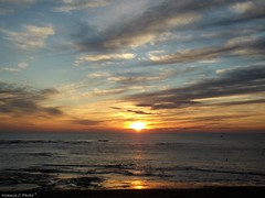 Entre ciel et mer (Noemie.C Photo) Tags: sunset sea sky sun mer seascape reflection beach colors clouds landscape soleil waves couleurs ciel outlook nuages paysage soir vagues plage reflets