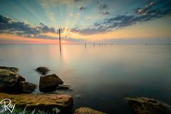 Sunset above Markermeer (Ray Fotografie) Tags: light sunset seascape stones nederland rays sunrays polder beams dike almere levee lightbeam markermeer landscapeclouds netherlkandslongexposure