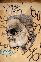 floating old man face (PDKImages) Tags: street city urban blackandwhite white streetart black art history monochrome animals architecture soldier graffiti eyes industrial doors cityscape colours faces sheffield yorkshire murals hidden listening doorways