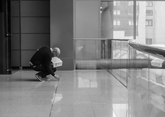 the inspector (Georgie Pauwels) Tags: reflection public floor candid streetphotography olympus checking inspector