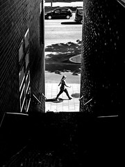 Full speed ahead (Per sterlund) Tags: street shadow bw monochrome stairs walking mono noiretblanc sweden stockholm sdermalm streetphotography panasonic streetphoto scandinavia bnw streetshot baw ringvgen 2016 streetbw gatufoto fotografadecalle fotografiadistrada strasenfotografie 14140mm streetbnw panasonicgx7
