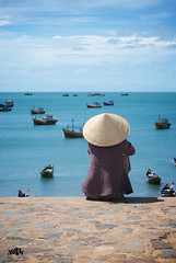Taking Time To Reflect (shotbywiles) Tags: street fish seaside fishing nikon vietnamese harbour streetphotography lookout vietnam fishingboats fishsauce seaview lookingout muine bluesea fishingharbour wiles d3000 wwwwilesphotographycom wilesphotography ukstreetphotographer