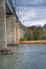 Au pied du pont (romaingirault) Tags: france nikon eau pont paysage hdr fleuve romanssurisre